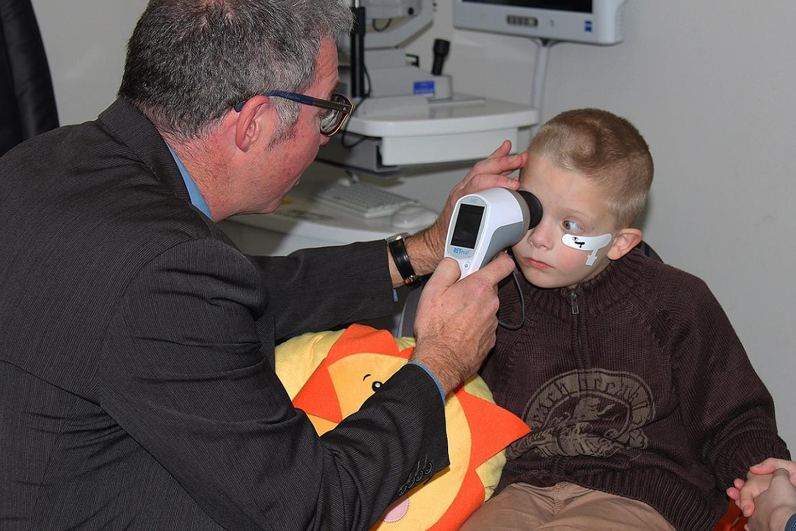 Australian researcher Paul Constable demonstrating his novel eye-scanning device that can reportedly diagnose autism in children