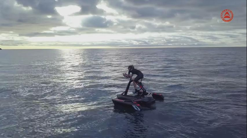 The RedShark trimaran features a retractable rudder, salt water-proof drive shaft, stainless steel nuts and bolts, and a folding design that allows it to be transported on a regular car-mounted bicycle rack