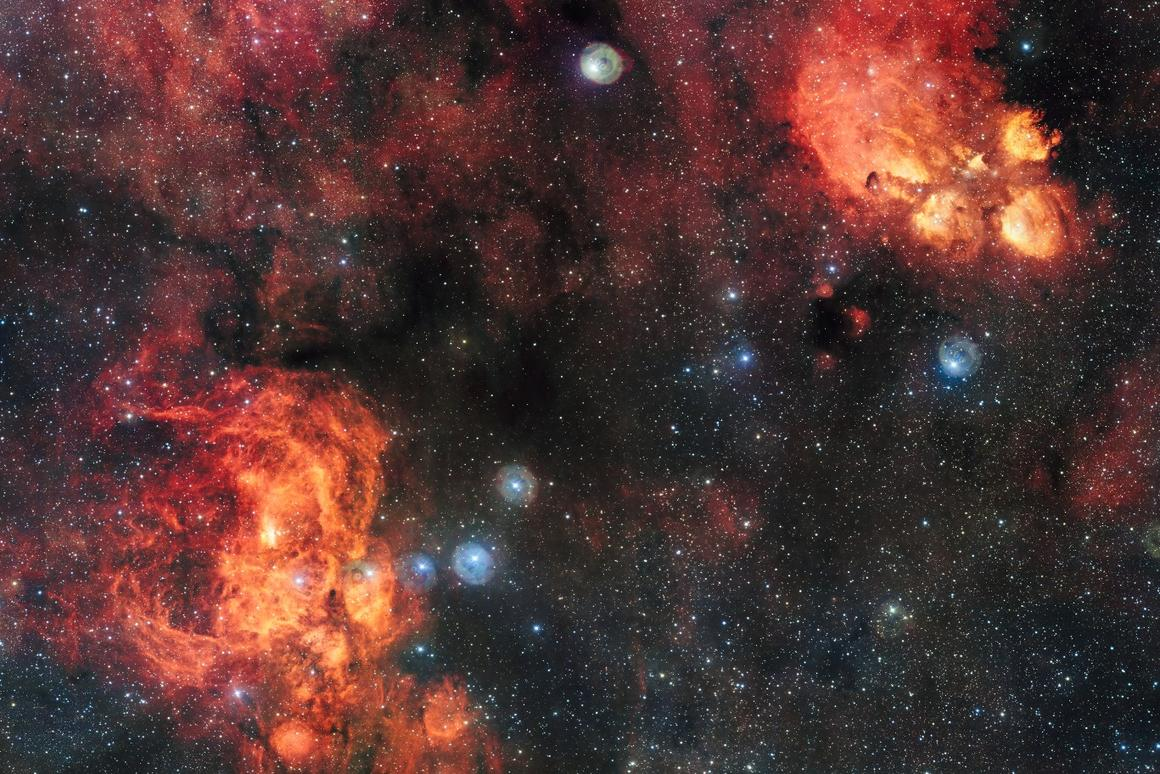 Though they appear side by side in the image, the Cat's Paw Nebula (top right) is far closer at 5,500 light-years, than the Lobster Nebula (bottom left), which sits roughly 8,000 light-years from Earth