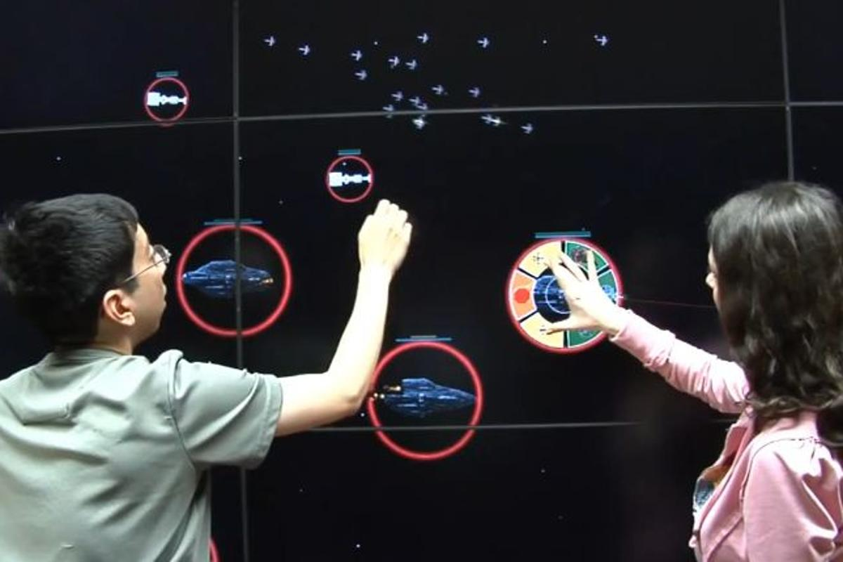 A graduate student has developed an RTS game played on a 20-foot wide LCD multi-touch wall (Image: University of Illinois)