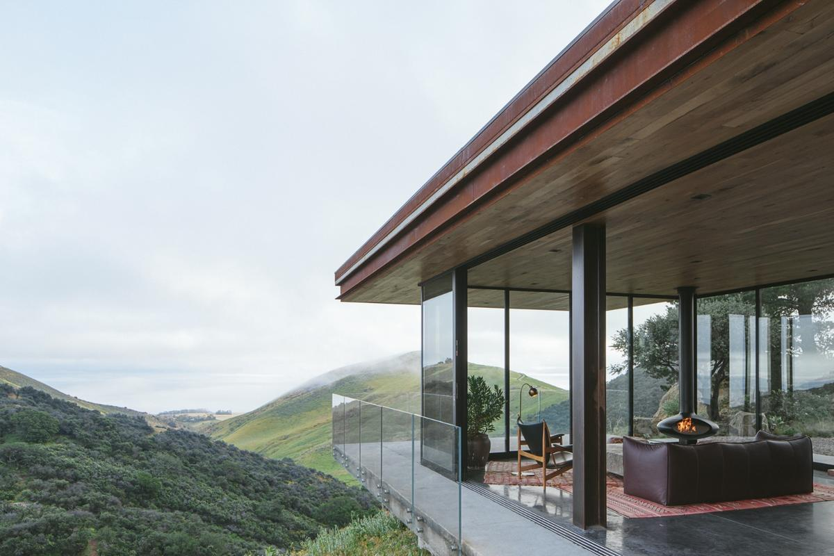 Much of the Off-Grid Guest House's glazing is operable and opens the home up to the outdoors