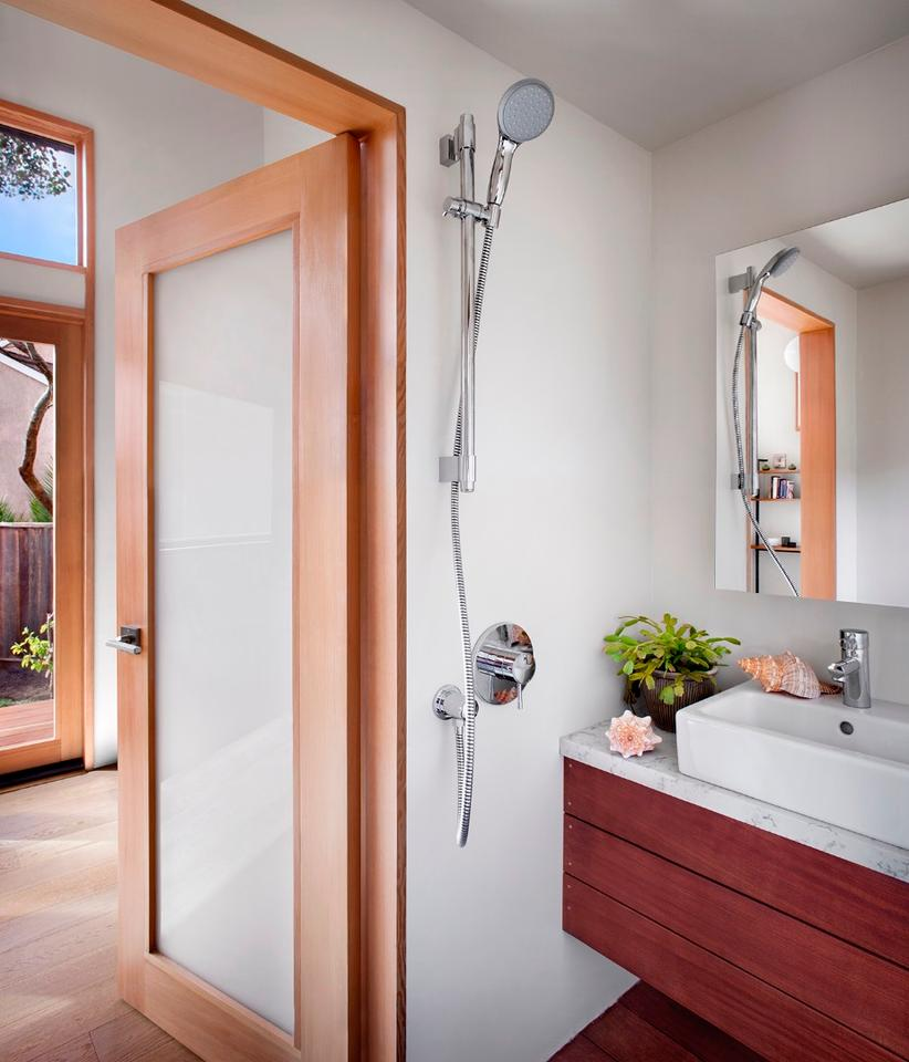 The snug bathroomincludes a shower,toilet, and sink