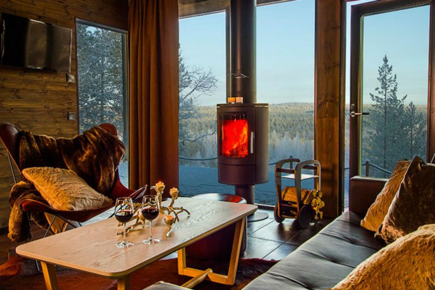Arctic GlassHouses include a sumptuous lounge with a fireplace, two bedrooms, a kitchenette, a spacious deck area, a private sauna, and, of course, breathtaking views of the Lapland scenery