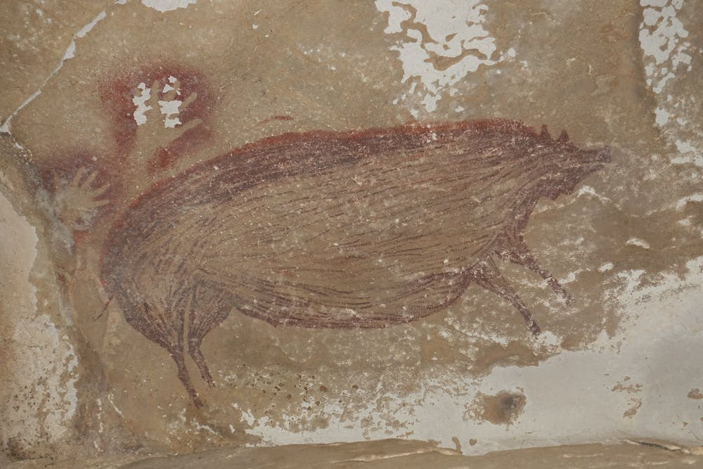 Dated more than 45,000 years ago, this cave painting found in Indonesia is the oldest known artwork depicting a reco