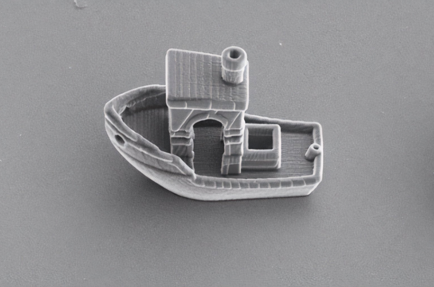 3DBenchy is a tiny 3D-printed boat, just a third of the thickness of a human hair