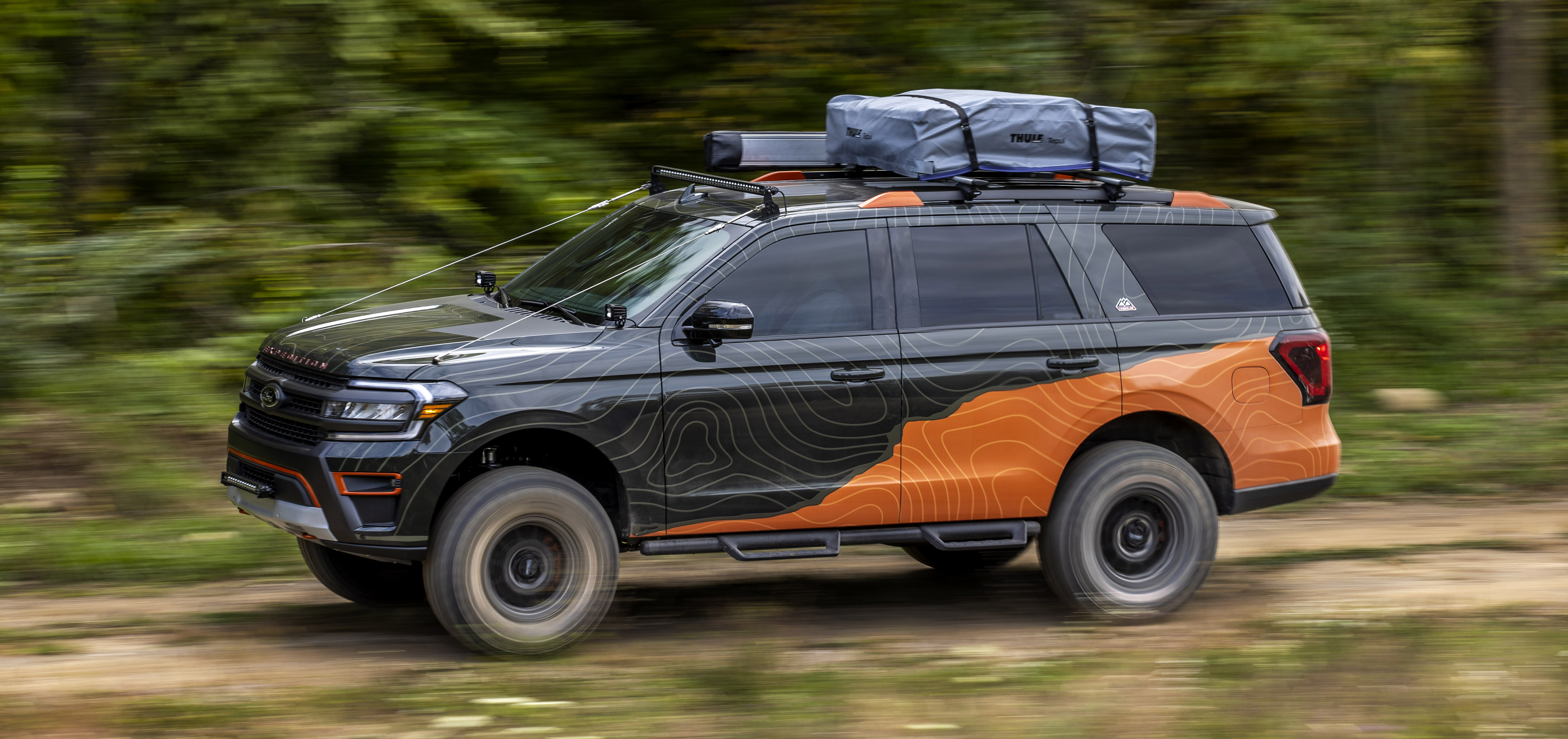 Up high, the Off-Grid concept packs a pair of Thule crossbars, a Thule Tepui rooftop tent and a 180-degree awning from Overland Vehicle Systems