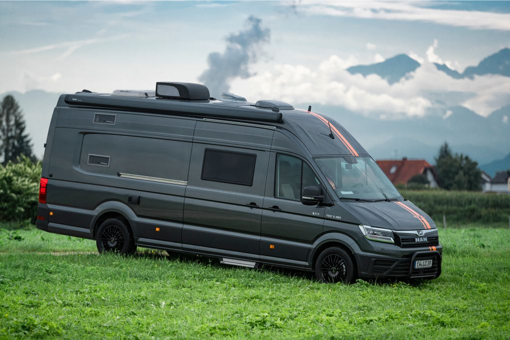 Landyacht camper van has high-sea luxury up front, toy garage in back